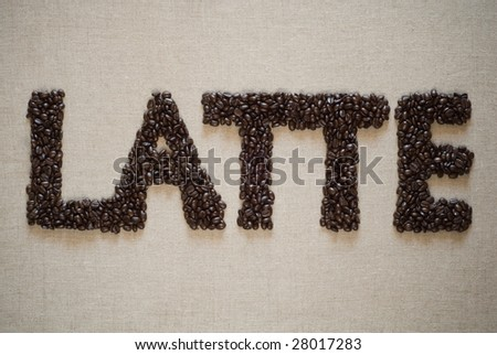 Coffee beans spelled Latte on a sack. - stock photo