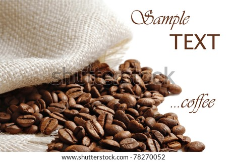 Coffee beans spilling from burlap sack on white background with copy space.  Macro with shallow dof. - stock photo