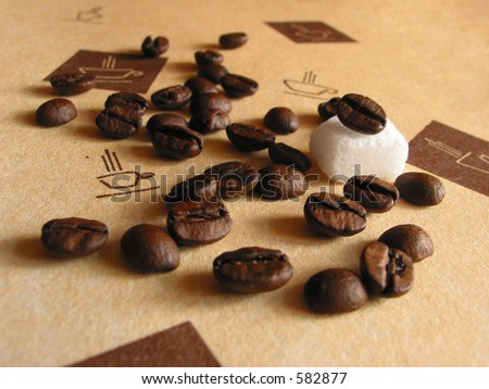 Coffee beans with a sugar piece - stock photo