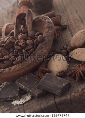 coffee beans with almond and chocolate - stock photo