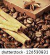 coffee beans with cinnamon sticks and chocolate - stock photo