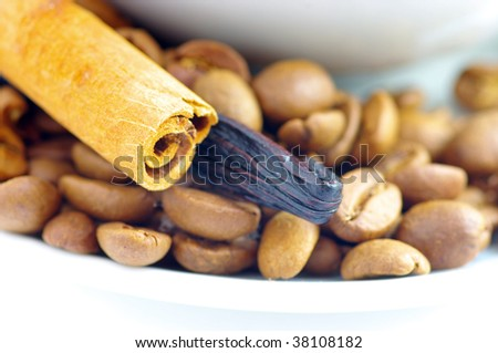 coffee beans with coffee cup and cinnamon, vanilla