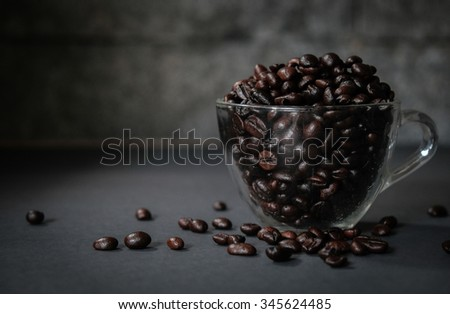 Coffee Beans with Cup on Dark Rustic Moody Background, Selective Focus - stock photo