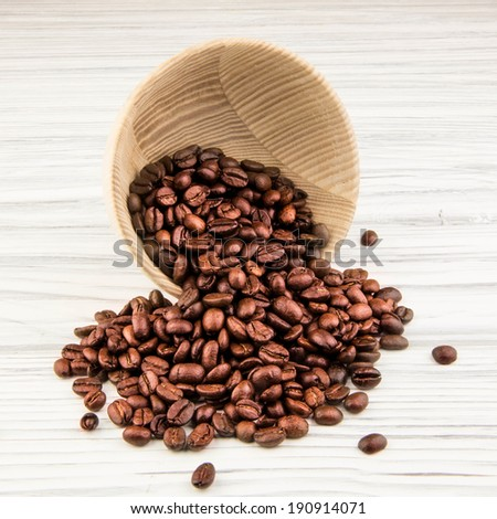 Coffee beans with old wooden kitchenware
