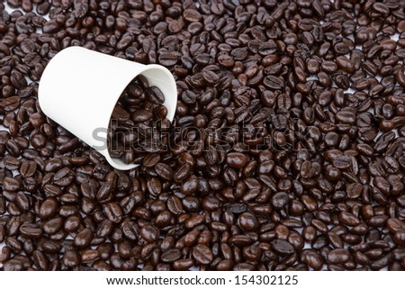 Coffee beans with paper cup