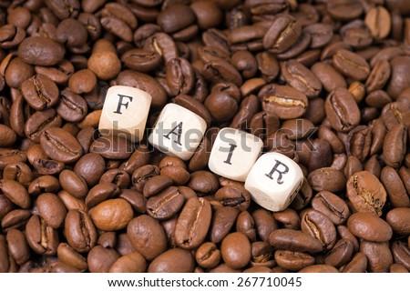 coffee beans with the word fair / Fair Trade - stock photo