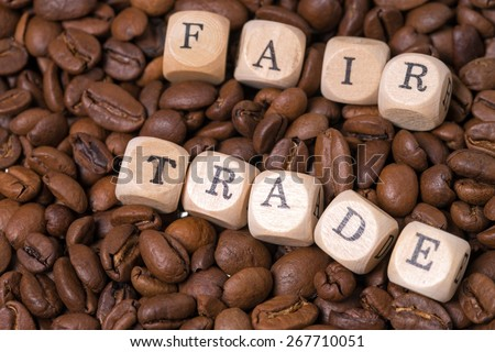 coffee beans with the word fair trade / Fair Trade - stock photo