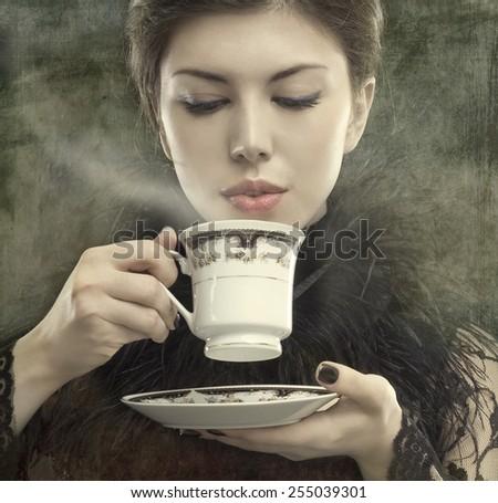 Coffee. Beautiful Girl Drinking Tea or Coffee. Cup. - stock photo