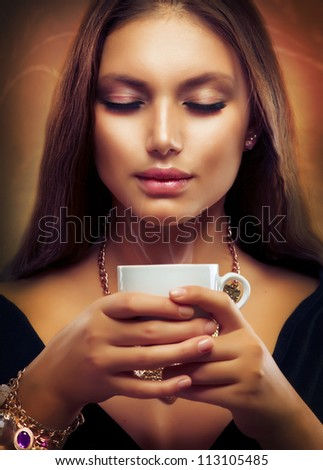 Coffee. Beautiful Girl Drinking Tea or Coffee. Cup of Hot Beverage - stock photo