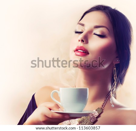 Coffee. Beautiful Girl Drinking Tea or Coffee. Cup of Hot Beverage
