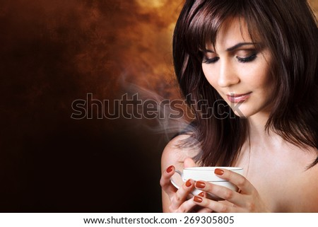 Coffee.  Beautiful Woman Drinking Tea or Coffee - stock photo