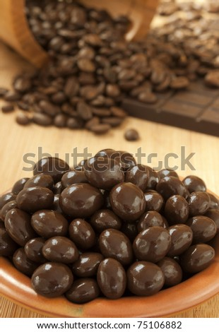 Coffee beens in chocolate - stock photo