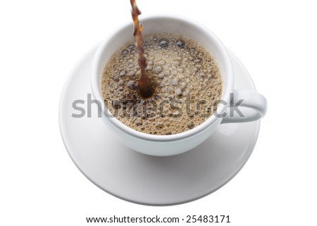 Coffee being poured into a white cup on a saucer,  isolated against white background