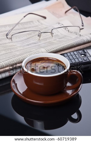 Coffee break with Espresso after reading stock news. - stock photo