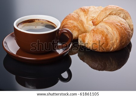 Coffee break with Espresso and french croissant. - stock photo