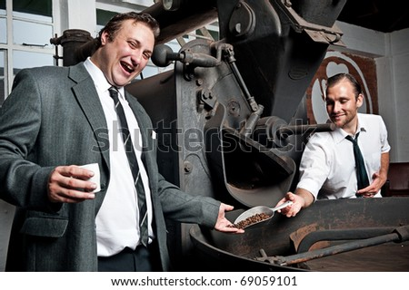Coffee businessmen are happy with the freshly roasted beans - stock photo