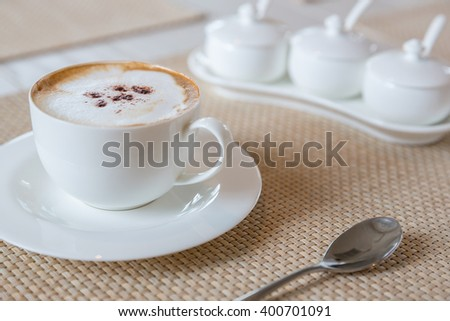 Coffee cappuccino in white cup - stock photo