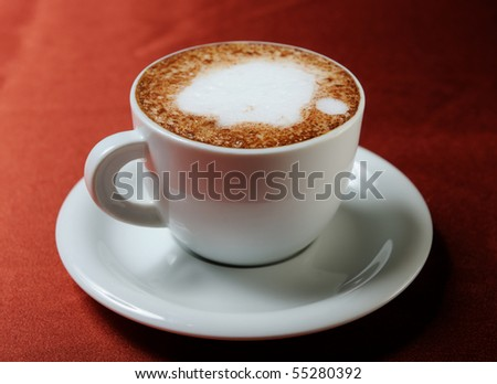 Coffee cappuccino on a red background - stock photo