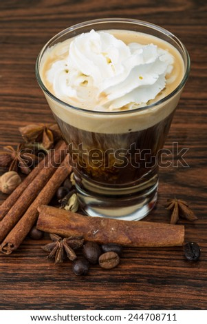 Coffee capuccino with cream and cinamon and star-anise - stock photo