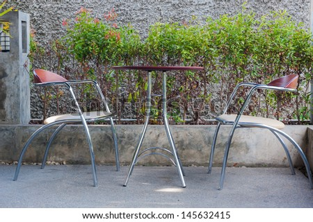 Coffee chop table and chair. - stock photo