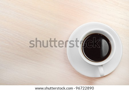 coffee classic cup on a wooden table top view