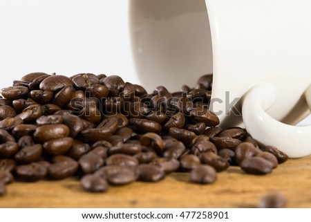 Coffee. Coffee beans. Coffee cup full of coffee beans. Toned image.