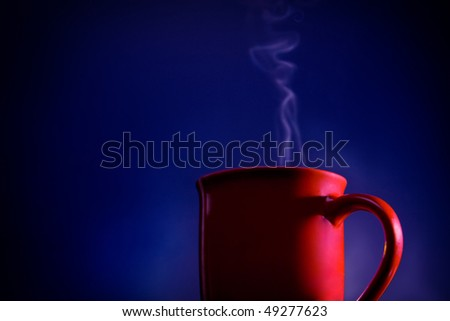 Coffee cup against a blue studio background