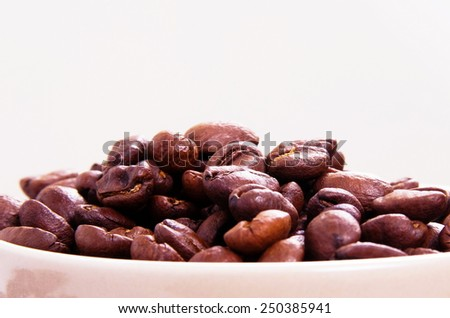 coffee cup and  beans closeup on table