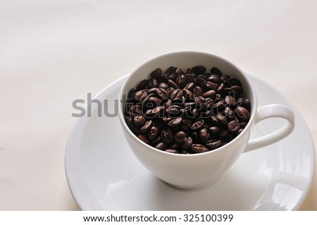 Coffee cup and beans.Coffee Background.