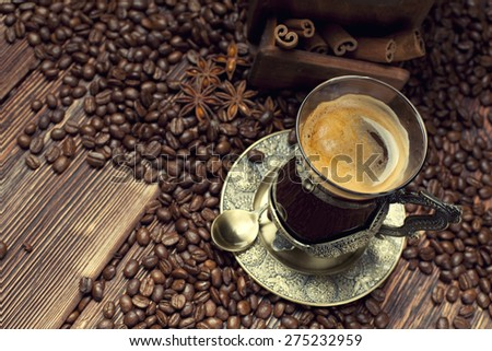 Coffee cup and beans, old coffee grinder  - stock photo