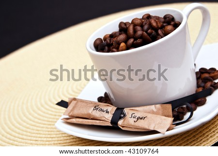coffee cup and beans with brown sugar
