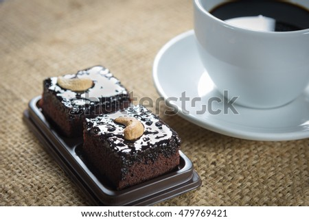 Coffee cup and beans with brownie