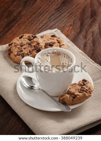 Coffee cup and biscuits on the table. - stock photo