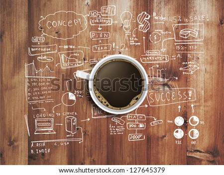 coffee cup and business strategy on wooden table - stock photo