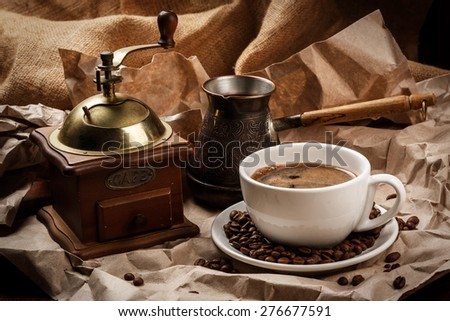 Coffee cup and cezve for turkish coffee and coffee mill