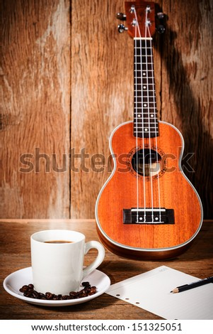 coffee cup and coffee beans and Ukulele with paper - stock photo