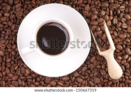 Coffee cup and coffee beans / coffee time - stock photo