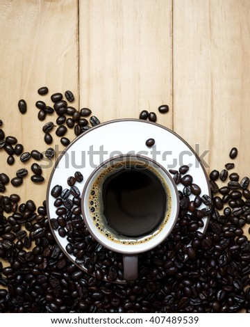 Coffee cup and coffee beans on a wood background., Flat lay. - stock photo
