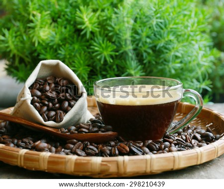 coffee cup and coffee beans  on basket weaving - stock photo
