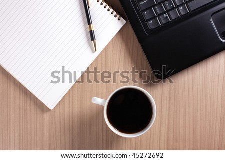 coffee cup and computer - break in office - stock photo