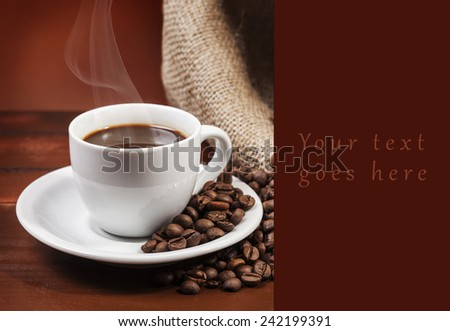 Coffee cup and jute sack full of coffee beans card - stock photo
