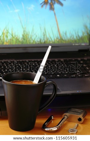 Coffee cup and key your computer. - stock photo