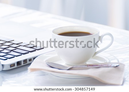 Coffee cup and laptop for business in coffee shop - stock photo