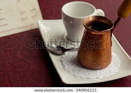 coffee cup and metal turk - stock photo