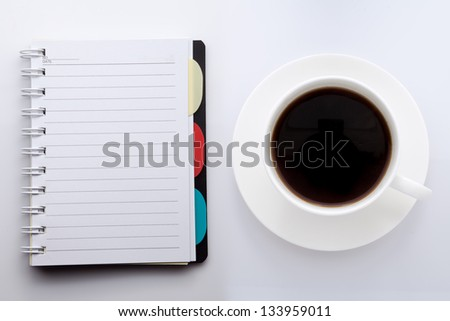 Coffee cup and note book - stock photo