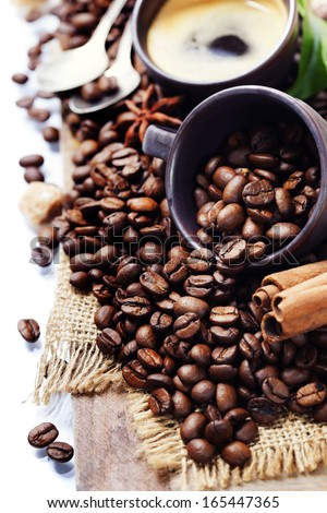 Coffee cup and roasted coffee beans - stock photo