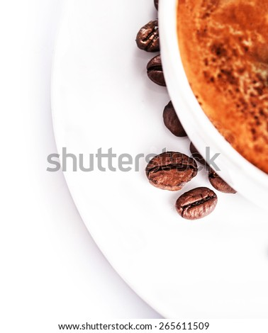 Coffee cup and roasted coffee beans isolated on a white background, close up. Coffee Espresso. Cup Of Coffee - stock photo