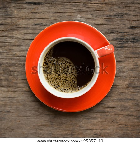 Coffee cup and saucer on a old wooden. - stock photo