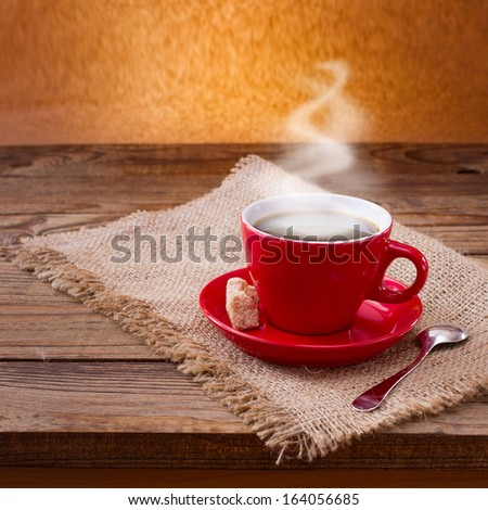 Coffee cup and saucer on  wooden table. Free space for your text - stock photo