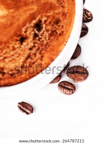 Coffee cup and saucer with roasted coffee beans isolated on a white background, close up  - stock photo